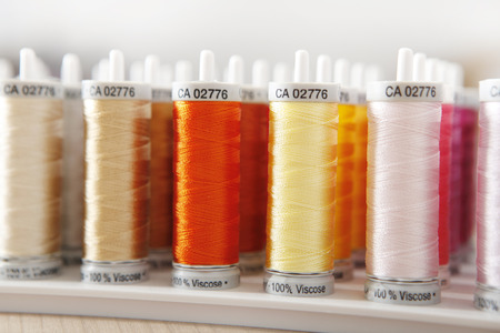 roles: many roles sewing thread in various colors Stock Photo