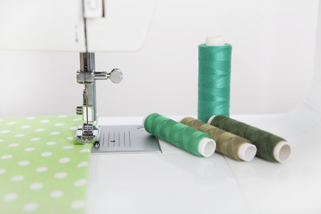 sewn: a cloth is sewn with a sewing machine, yarn of different colors