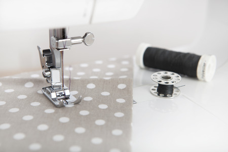 sewn: a cloth is sewn with a sewing machine, black yarn is next