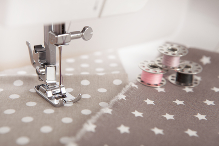 stitching machine: a cloth is sewn with a sewing machine, different yarns are next