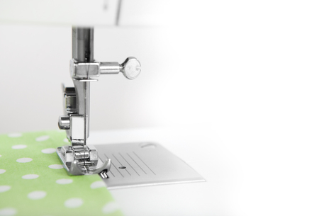 sewn: a fabric is sewn with a sewing machine, copy space