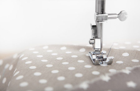 stitching machine: a fabric is sewn with a sewing machine, copy space