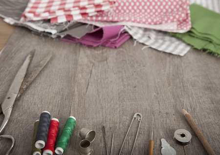 craft material tinker: colorful fabrics and accessories to tailor lie on a wooden underground