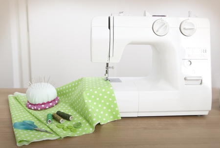 craft material tinker: with a sewing machine, a green cloth is sewn