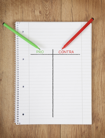 cons: a notepad with a pros and cons chart