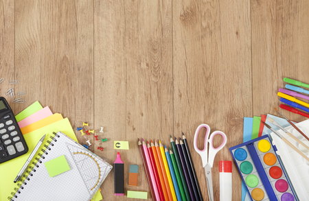 wooden surface: pens and paper for painting or creative tinker on wooden surface