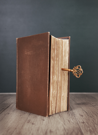 an old book closed with a key Standard-Bild