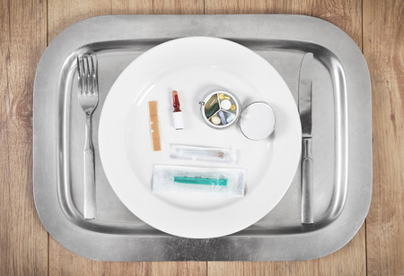 intake: Medicine and syringe lying on a plate for intake