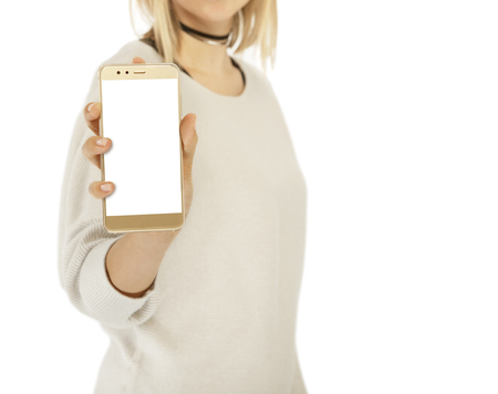 a woman holds a smartphone to the front, no face, isolated Reklamní fotografie