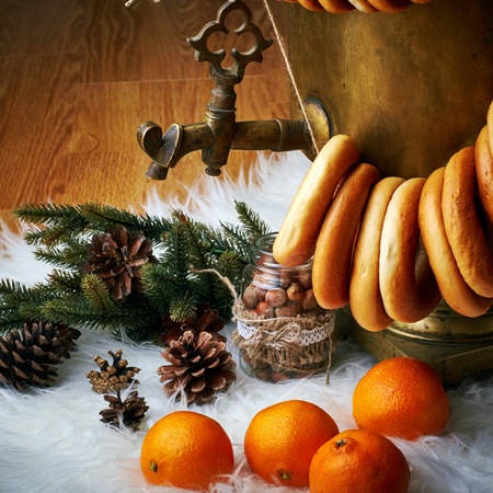joyous festivals: Christmas still life tangerines and bumps, a samovar and steering-wheels Stock Photo