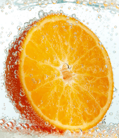 carbonated: Orange in a glass of carbonated water Stock Photo