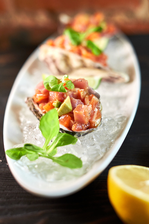 fryed: Delicious red fish in the shells of shellfish. With lemon and lime jpg