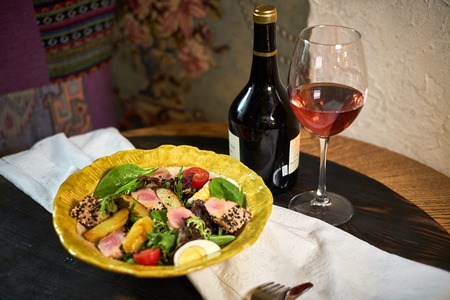Salad with tuna and vegetables on a nice plate jpg
