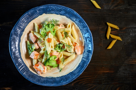 finocchio: close-up of plate of pasta and smoked salmon with tomato