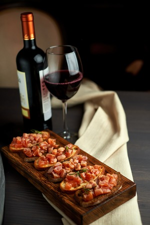 bruschetta with delicious fish on a cream cushion with capers and olive oil Stock Photo