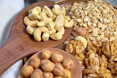 Various nuts on stone table. Top view with copy space Standard-Bild - 109329105