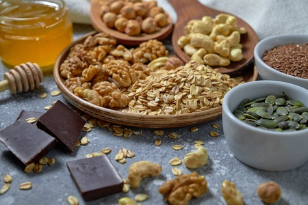 Various nuts on stone table. Top view with copy space Standard-Bild - 109329110