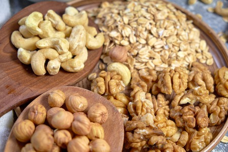 Various nuts on stone table. Top view with copy space Standard-Bild - 109329114