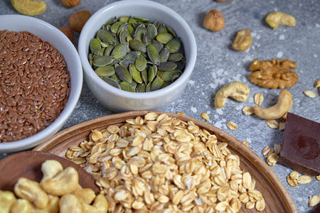 Various nuts on stone table. Top view with copy space Standard-Bild - 109329115
