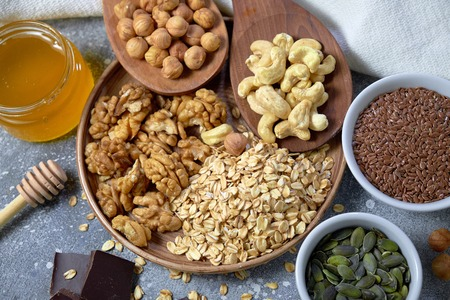 Various nuts on stone table. Top view with copy space Standard-Bild - 109329119