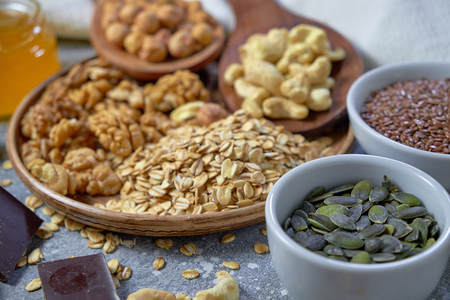 Various nuts on stone table. Top view with copy space Standard-Bild - 109329817