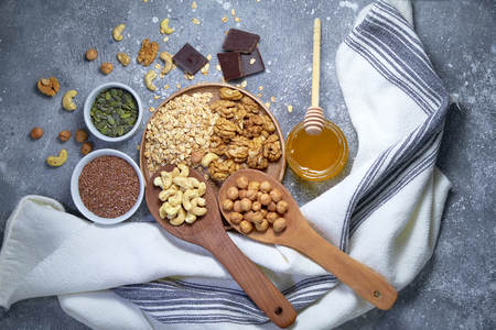 Various nuts on stone table. Top view with copy space Standard-Bild - 109329469