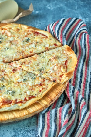 Slice of hot pizza large cheese lunch or dinner crust seafood meat topping sauce. with bell pepper vegetables delicious tasty fast food italian traditional on wooden board table classic in view Standard-Bild - 114399075