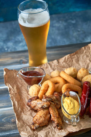 Grilled sausages with glass of beer pic Standard-Bild - 114399105