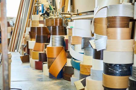 warehouse with veneer rolls, production of interior doors
