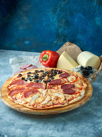 Slice of hot pizza large cheese lunch or dinner crust seafood meat topping sauce. with bell pepper vegetables delicious tasty fast food italian traditional on wooden board table classic in view 版權商用圖片