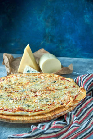 Slice of hot pizza large cheese lunch or dinner crust seafood meat topping sauce. with bell pepper vegetables delicious tasty fast food italian traditional on wooden board table classic in view Imagens