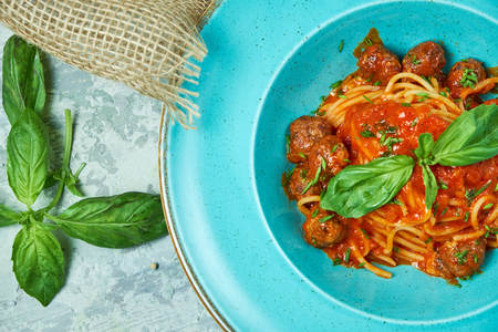 Pasta with meat balls. Beautiful serving dishes. Restaurant menu