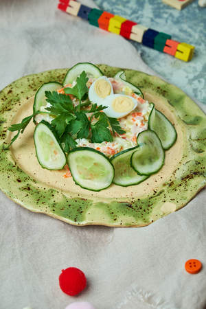 Childrens salad with crab and cucumber slices
