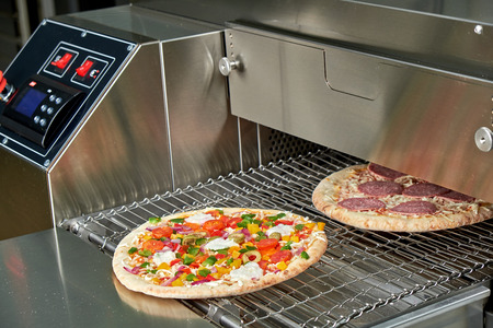 Industrial electric pizza oven for catering. Professional kitchen equipment 스톡 콘텐츠