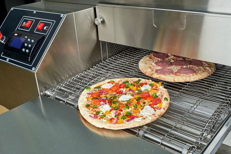 Industrial electric pizza oven for catering. Professional kitchen equipment Imagens
