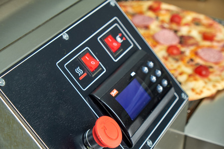 Industrial electric pizza oven for catering. Professional kitchen equipment Reklamní fotografie