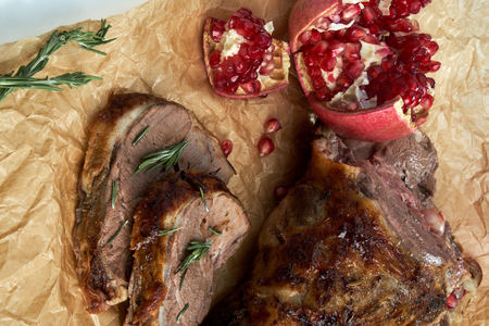 Slice of baked red meat. Beautiful serving dishes