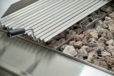Kitchen electric grill with stones for the network catering. Professional kitchen equipment