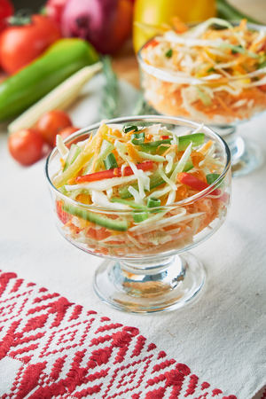 Cabbage and carrot salat. Beautiful serving dishes. Restaurant menu