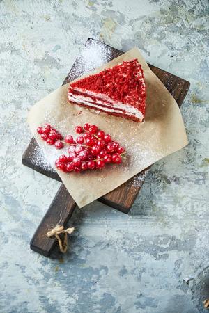 Red velvet cake. Gray textured background. Dessert. Food chain