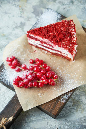 Red velvet cake. Gray textured background. Dessert. Food chain
