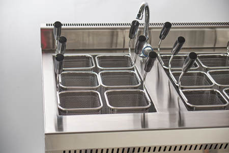 Steam electric stove for second courses. Kitchen industrial equipment. Catering Imagens