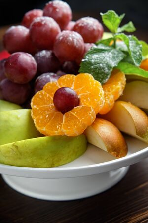 Sliced fruits on a white plate
