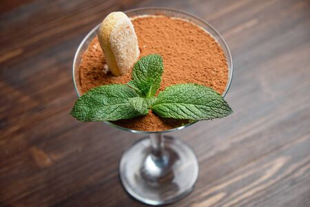 Tiramisu in a glass vase . catering menu