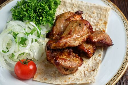 Skewers of chicken with thin pita bread . catering menu