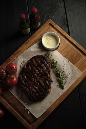 Meat steak on a wooden board. catering menu