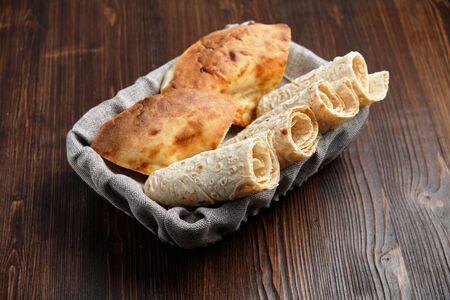 Pita bread of different types in a bread basket . restaurant menu Stockfoto