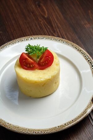 Mashed potatoes with tomatoes . catering menu 写真素材