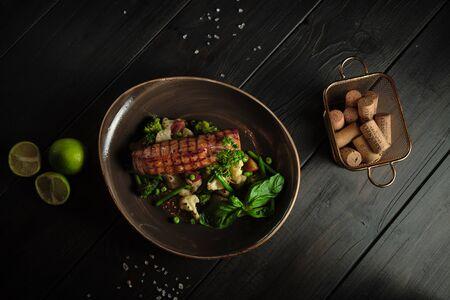 Grilled fish steak with broccoli and cauliflower. catering menu Standard-Bild
