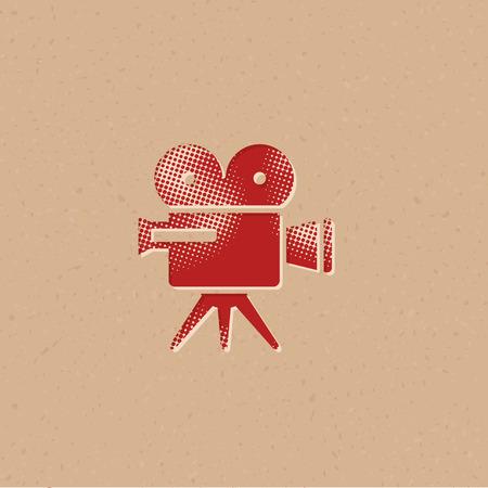 Movie camera icon in halftone style. Grunge background vector illustration.